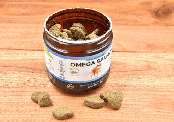 A bottle of OmegaSalmon soft chewable salmon oil treats for dogs