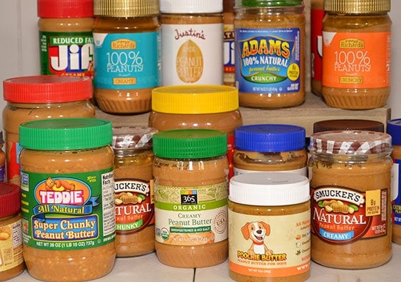 A photo of all the different jars of peanut butter we tested and reviewed for dogs