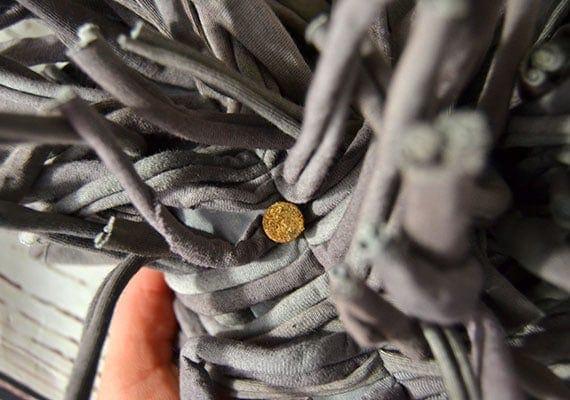 A single piece of kibble hiding inside paw5 wooly snuffle mat
