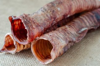 A stack of dried beef trachea dog chews