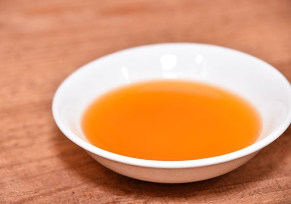 Bowl of liquid salmon oil for dogs