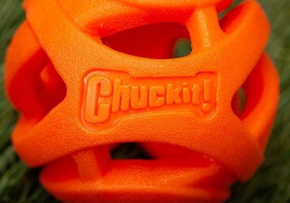 Close up on Chuckit! Breath Right orange dog tennis ball open lattice structure