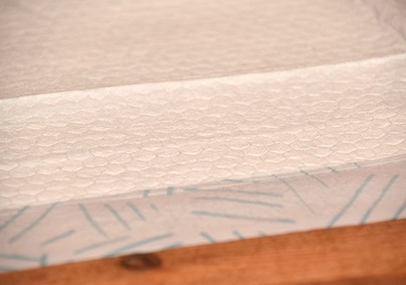 Close up on absorbent quilted top layer of Bark XXL Pee Pads - Best Giant Pee Pad For Dogs Winner
