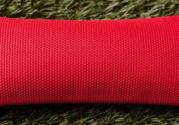 Close up on surface of red fire hose dog toy