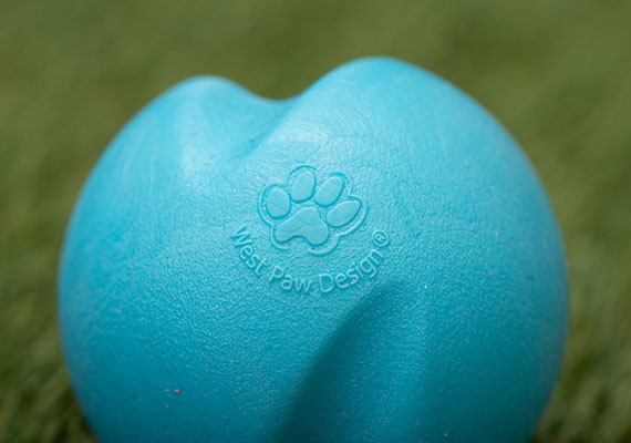 Close up on the surface of blue West Paw Jive dog tennis ball