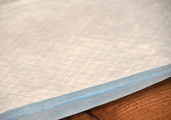 Close up on top layer of Kirkland Signature Extra Large Absorbent Pads - Winner of best large pee pad for dogs