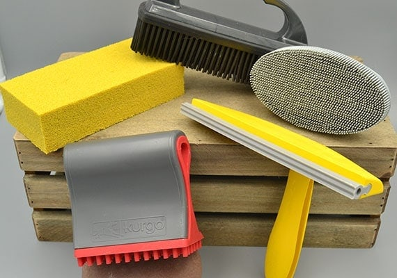 Different types of pet hair removers for various surfaces and materials