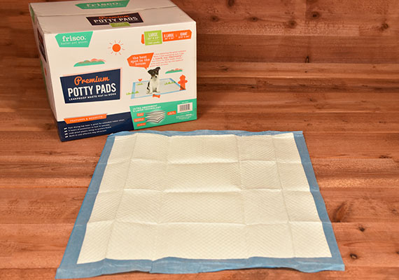 Frisco Training and Potty pad laid flat next to box - winner of best budget pee pad for dogs