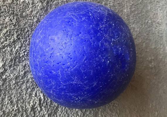 Hard plastic soccer ball with chews and scratches from dog