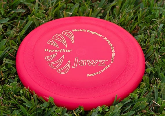Hyperflite Jawz frisbee after it landed on grass in park