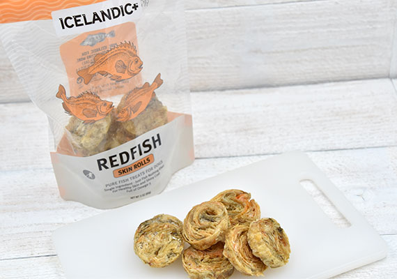 Icelandic Plus Redfish Skin Rolls treats for dogs open bag next to individual treats