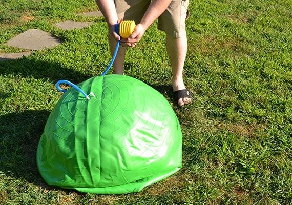 Inflating the Jolly Mega Ball herding ball with an air pump