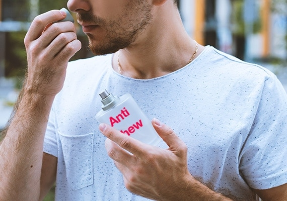 Man smelling the cap of anti chew spray