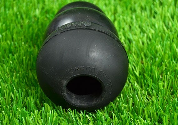 Opening on the bottom of the Kong Extreme Black Rubber Chew Toy