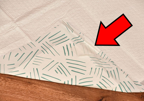 Sticky tab located on the underside of BARK XXL Pee Pads - Winner of best giant pee pads for dogs