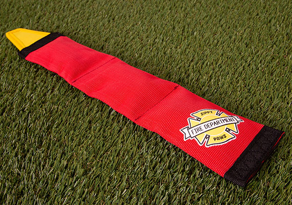 ZippyPaws Firehose Blaster Dog Toy - long fire hose toy sitting on grass