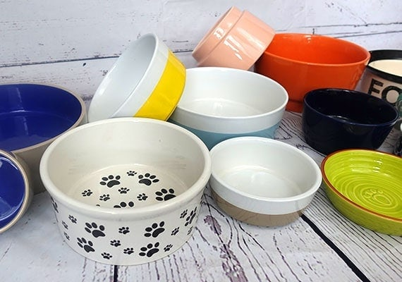 Ceramic dog bowls in a pile ready to be tested and reviewed