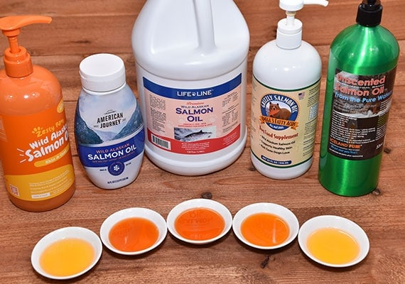 comparing different bottles of salmon oil for dogs